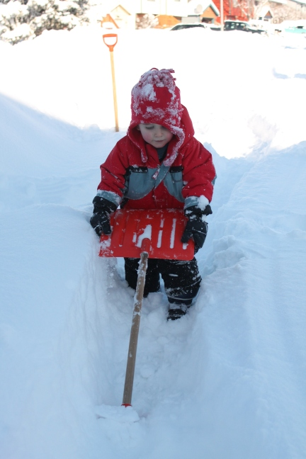 He loves to turn the shovel upside down and pretend to snowblow
